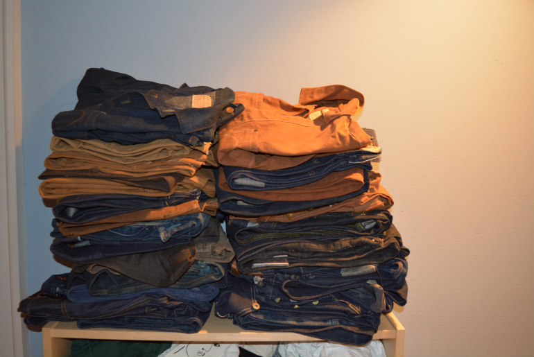 Stack of Denim and Duck, with a couple of shirts on top.