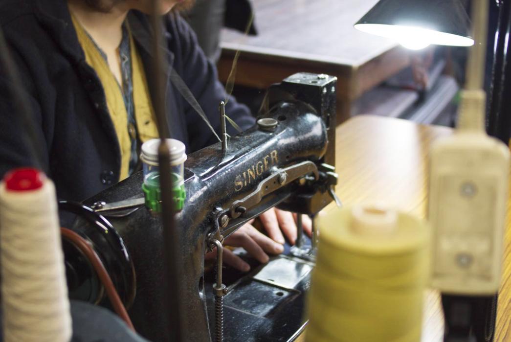 a-photo-tour-of-ooe-yofukuten-raw-denim-in-japan-hiro-showing-me-a-double-needle-chain-sticher