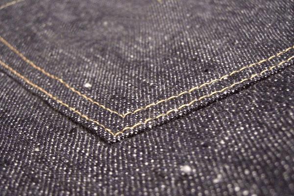 Close up of a raw slub denim