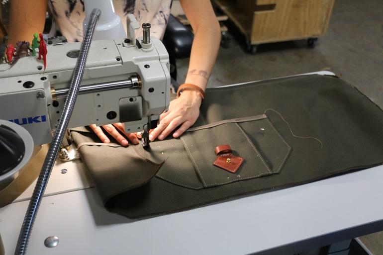 Sewing production inside Tanner Goods's Portland workshop