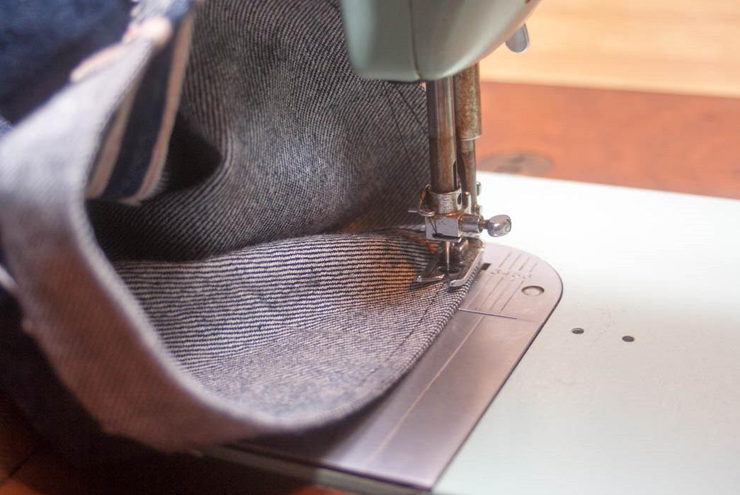 Sewing the raw hem.