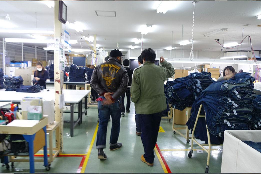 Donwan Harrell walking factory floor.