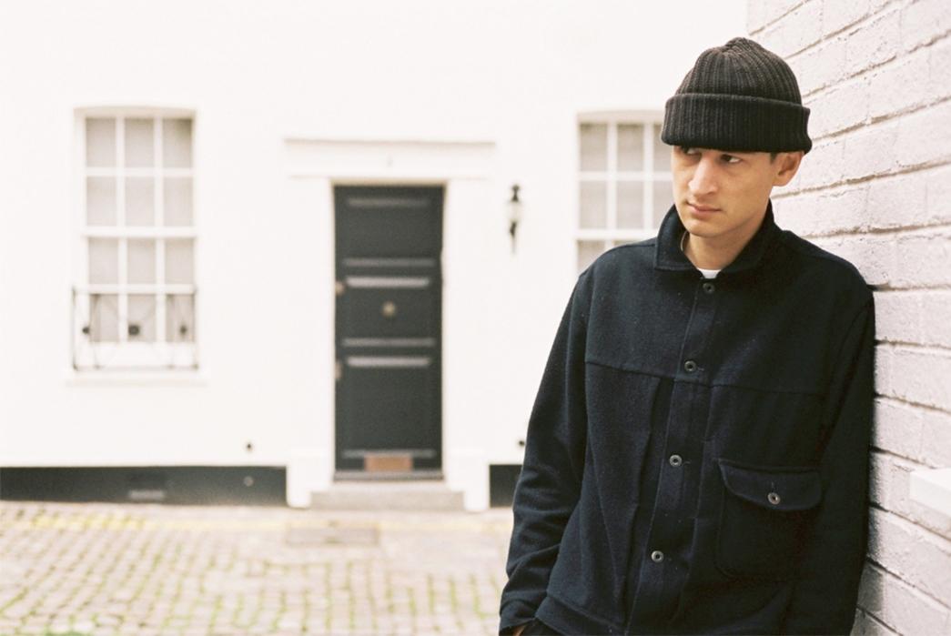 evan-kinori-melton-wool-pleated-jacket-model-on-wall