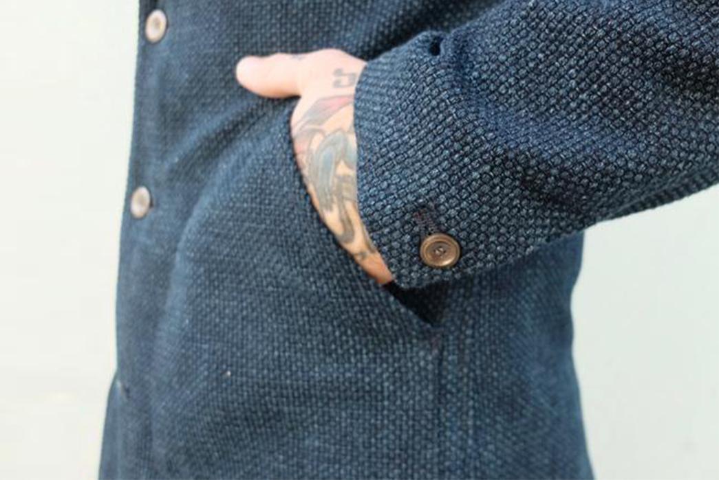 nine-lives-indigo-sashiko-duster-coat-hand-in-pocket