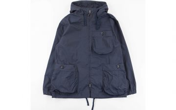 tss-navy-high-count-poly-oxford-gathered-round-pocket-zip-up-parka-front