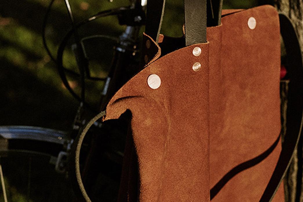 Knickerbocker-Mfg.-Co.-x-D'emploi-Suede-Souvenir-Mail-Bag-on-bike
