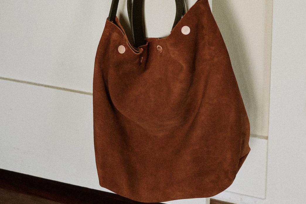 Knickerbocker-Mfg.-Co.-x-D'emploi-Suede-Souvenir-Mail-Bag-on-door