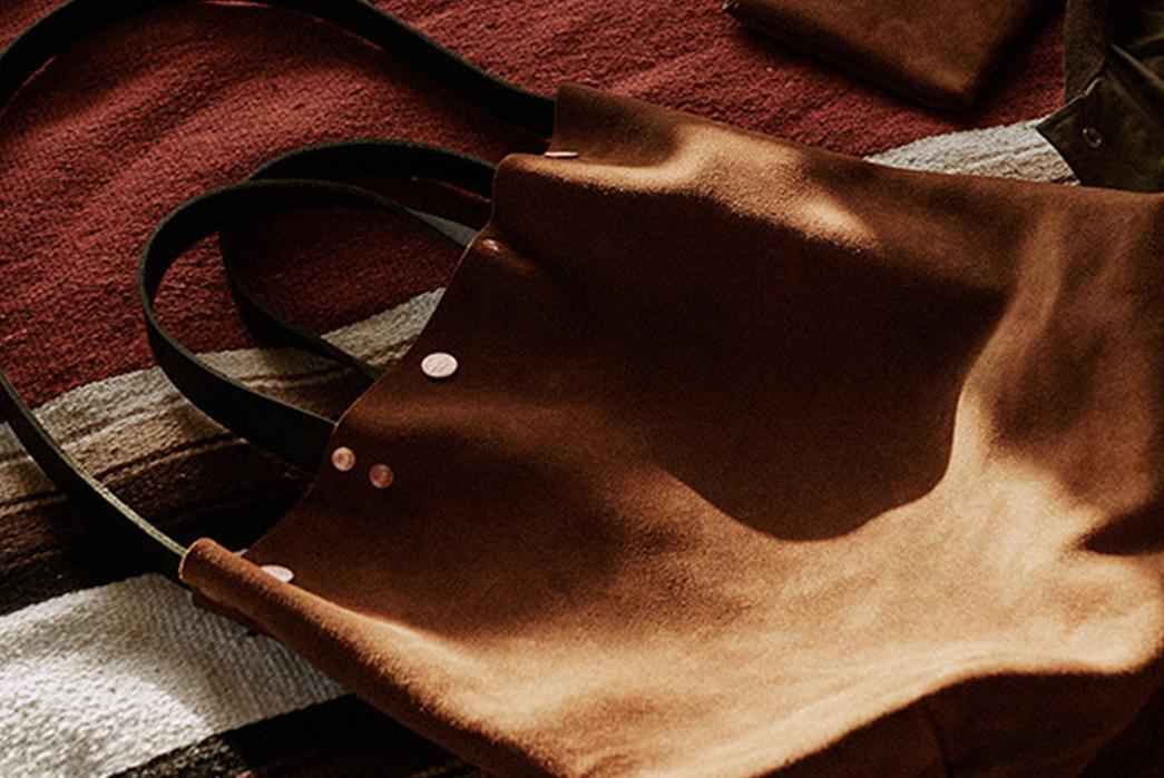 Knickerbocker-Mfg.-Co.-x-D'emploi-Suede-Souvenir-Mail-Bag-on-floor
