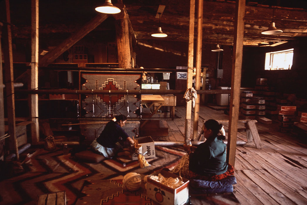 Weavers creating blankets at the Hubbel Trading Post in 1972. Image Environmental Protection Agency via Tom Clark.