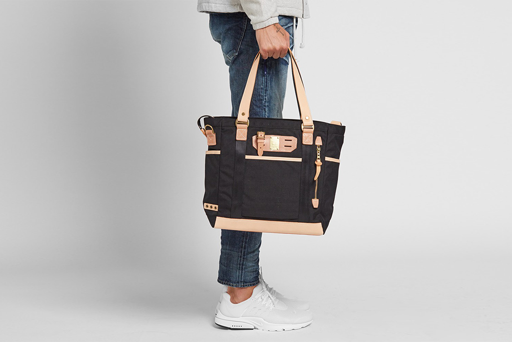 Master-Piece's-Surpass-Tote-Has-All-the-Bells-and-Whistles-in-hand-model-front