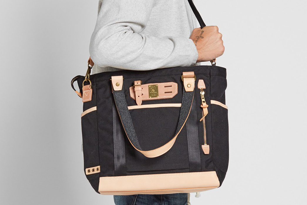 Master-Piece's-Surpass-Tote-Has-All-the-Bells-and-Whistles-on-shoulder-model-front