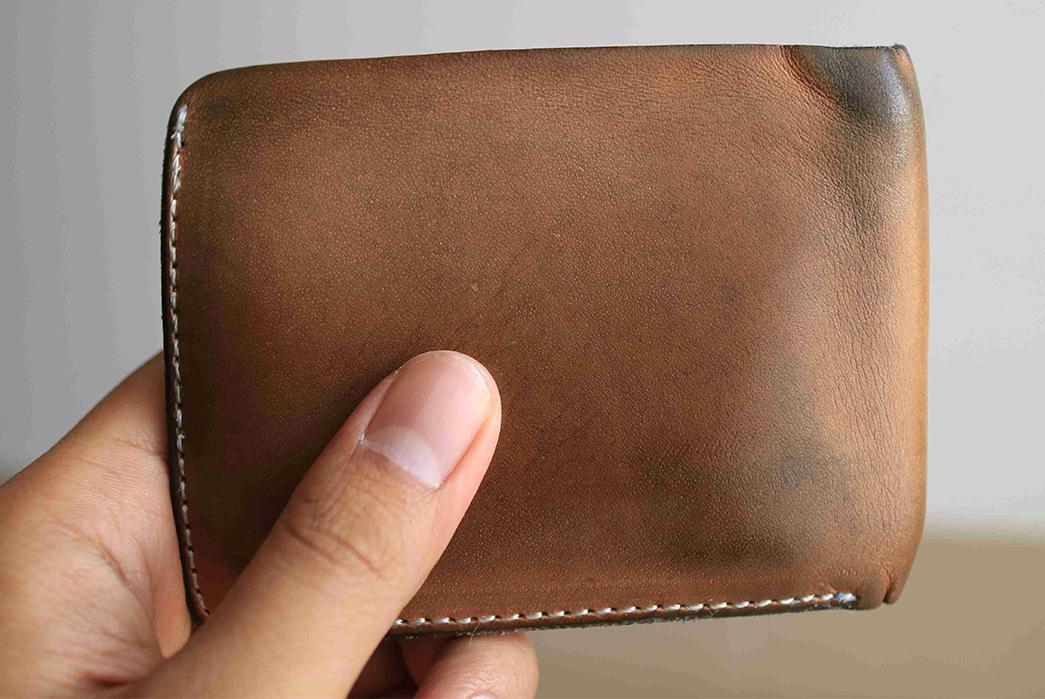 Fade-of-the-Day---LTHRKRFT-veg-tan-bifold-wallet-(9-Months)-in-hand