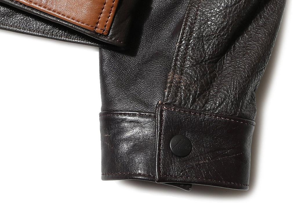 Needles-Rebuild-Leather-Jean-Jacket-back-sleeve