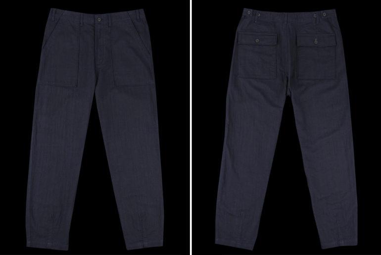 universal-works-double-denim-herringbone-fatigue-pants-front-back</a>