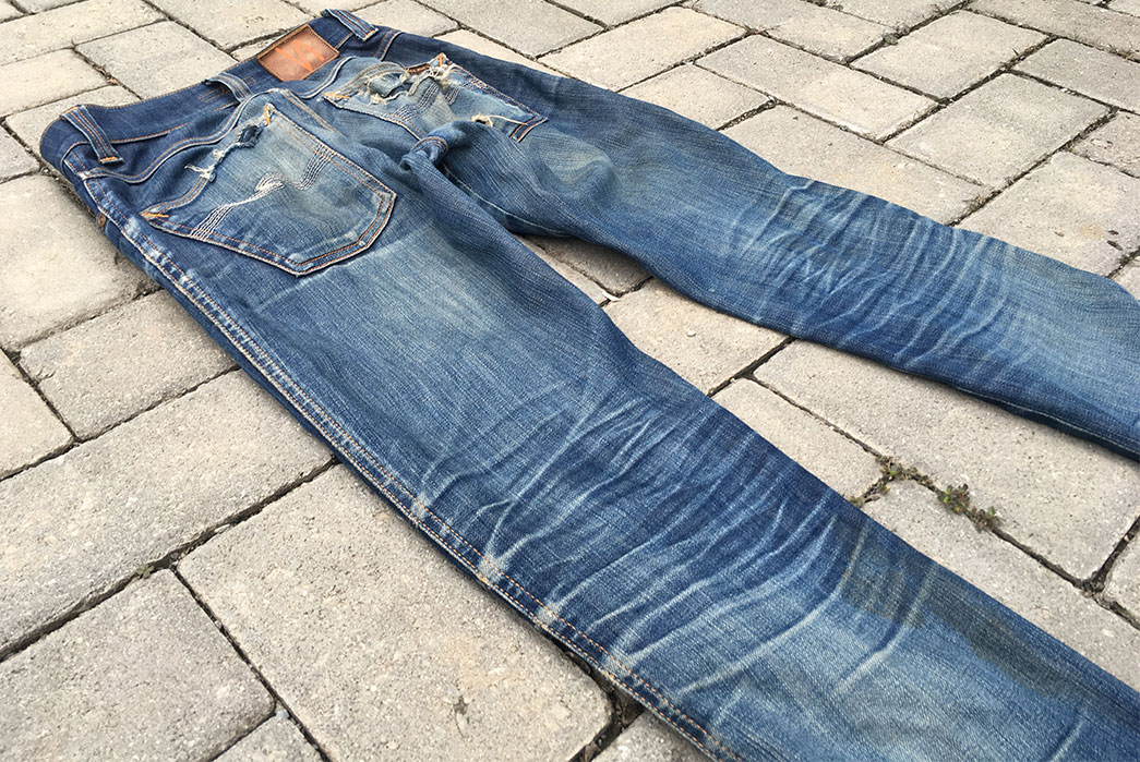 Fade-of-the-Day---Nudie-Slim-Jim-Dry-Ecru-Embo-(7-Years,-4-Washes)-back-angle