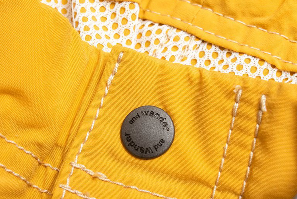 And-Wander-Climbing-Shorts-yellow-front-button