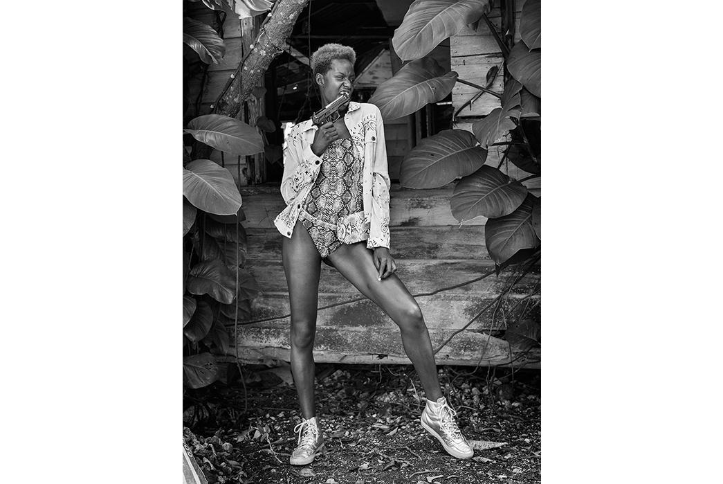 Kapital's-Yardie-Blues-Lookbook-Meanders-Through-Jamaica-and-Misadventure-bw-female-with-gun