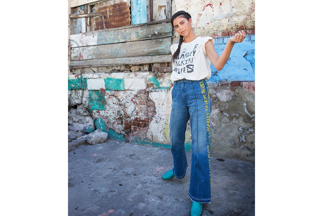 Kapital's-Yardie-Blues-Lookbook-Meanders-Through-Jamaica-and-Misadventure-female-in-a-front-of-old-house-2