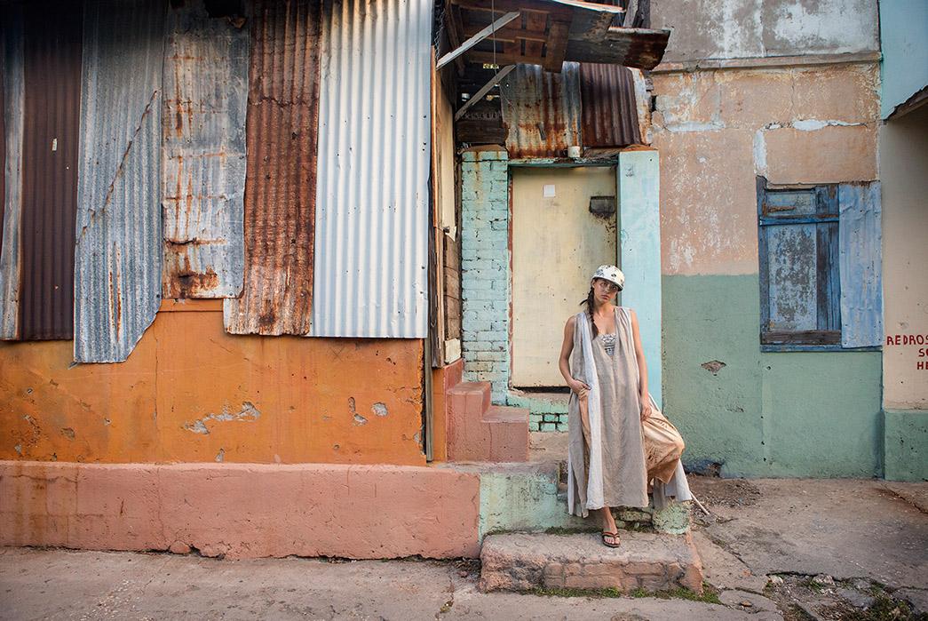 Kapital's-Yardie-Blues-Lookbook-Meanders-Through-Jamaica-and-Misadventure-female-in-a-front-of-old-house