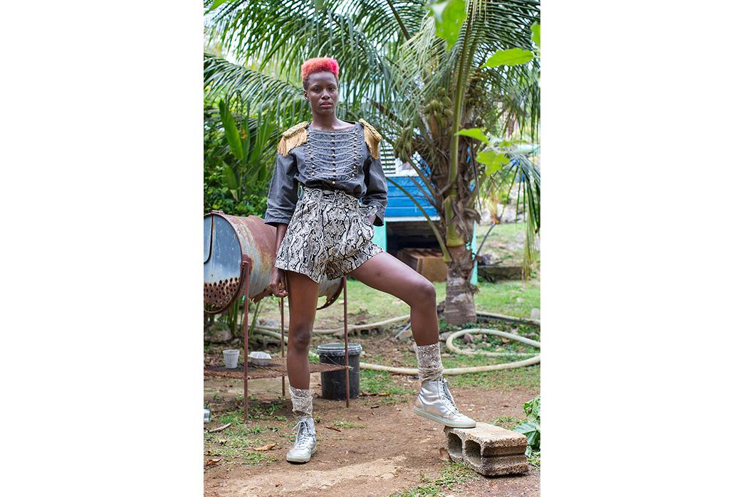 Kapital's-Yardie-Blues-Lookbook-Meanders-Through-Jamaica-and-Misadventure-female-in-a-front-of-palm