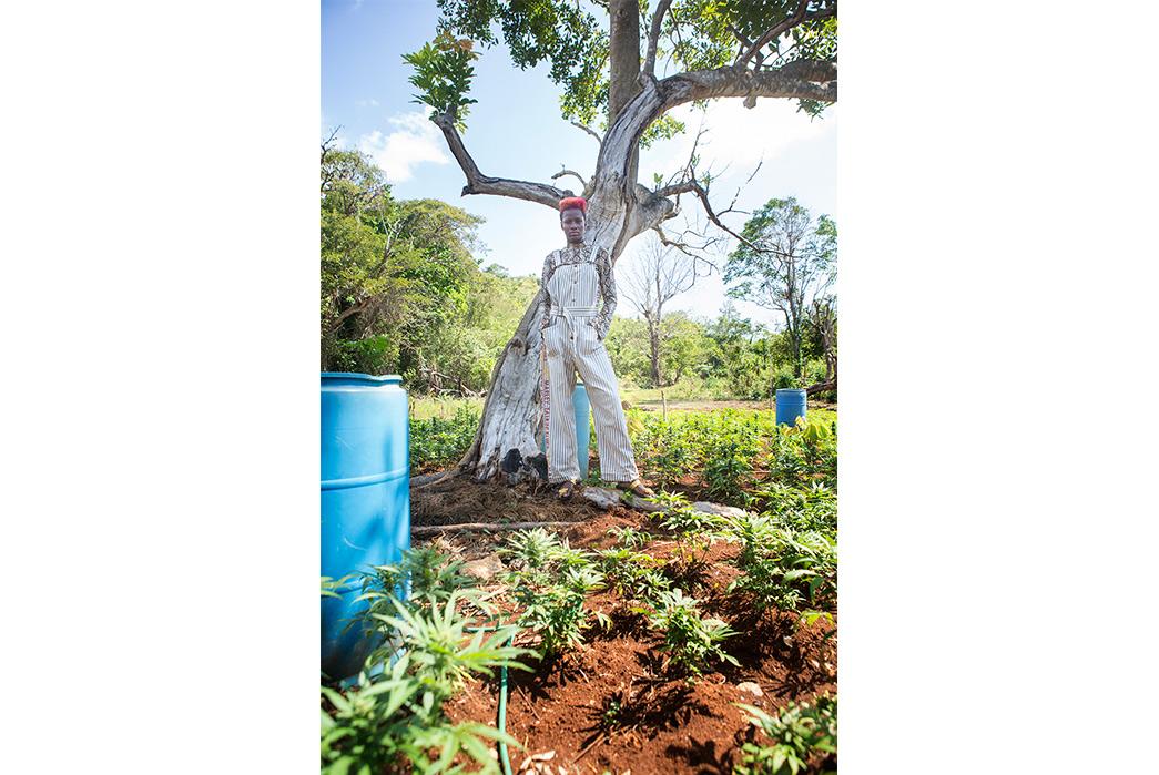 Kapital's-Yardie-Blues-Lookbook-Meanders-Through-Jamaica-and-Misadventure-female-in-a-frotn-of-tree