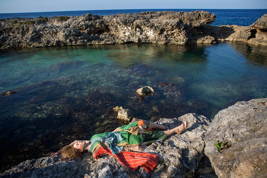 Kapital's-Yardie-Blues-Lookbook-Meanders-Through-Jamaica-and-Misadventure-female-lying-on-stone-near-the-sea