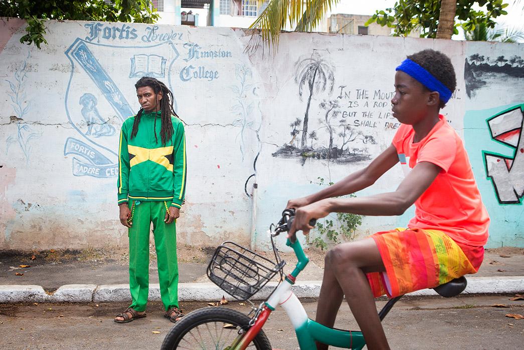 Kapital's-Yardie-Blues-Lookbook-Meanders-Through-Jamaica-and-Misadventure-male-and-kid-on-bike