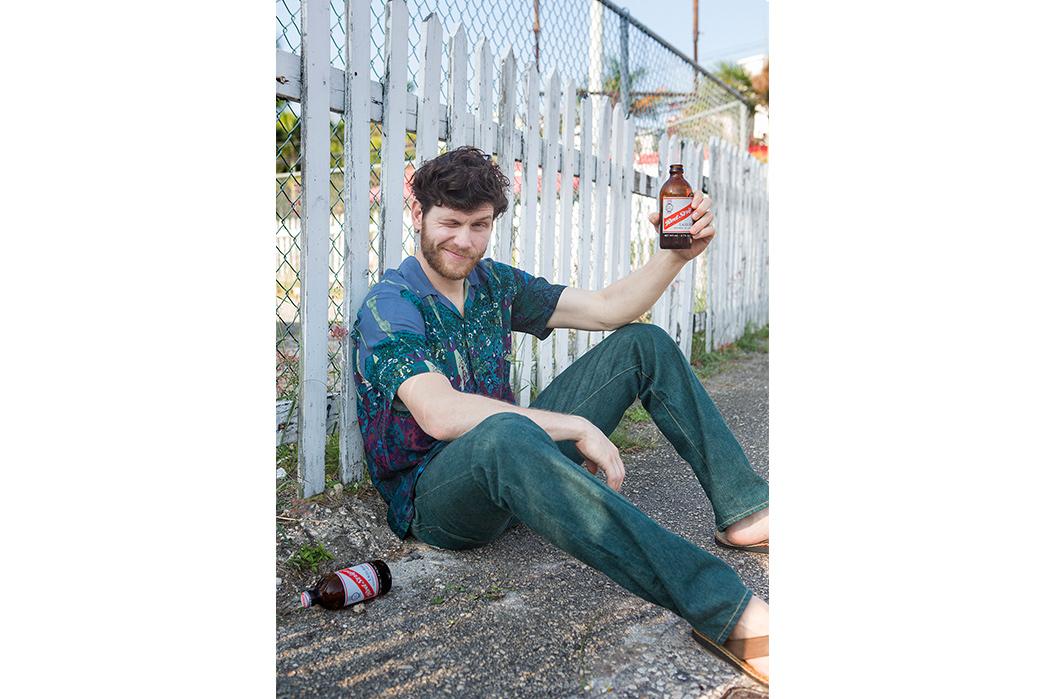 Kapital's-Yardie-Blues-Lookbook-Meanders-Through-Jamaica-and-Misadventure-male-drinking
