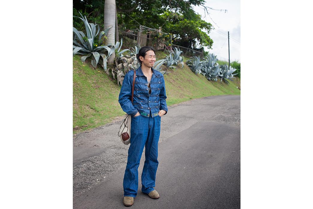 Kapital's-Yardie-Blues-Lookbook-Meanders-Through-Jamaica-and-Misadventure-male-in-blue-on-asphalt