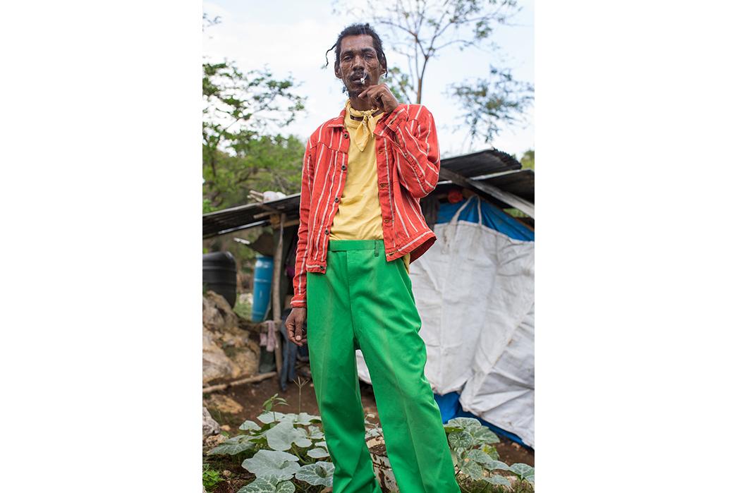 Kapital's-Yardie-Blues-Lookbook-Meanders-Through-Jamaica-and-Misadventure-male-in-green-pants-smoking