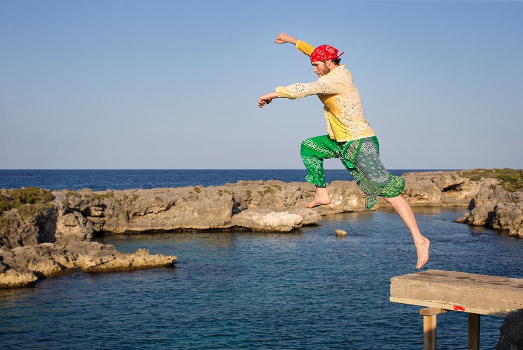 Kapital's-Yardie-Blues-Lookbook-Meanders-Through-Jamaica-and-Misadventure-male-jumping-in-the-sea