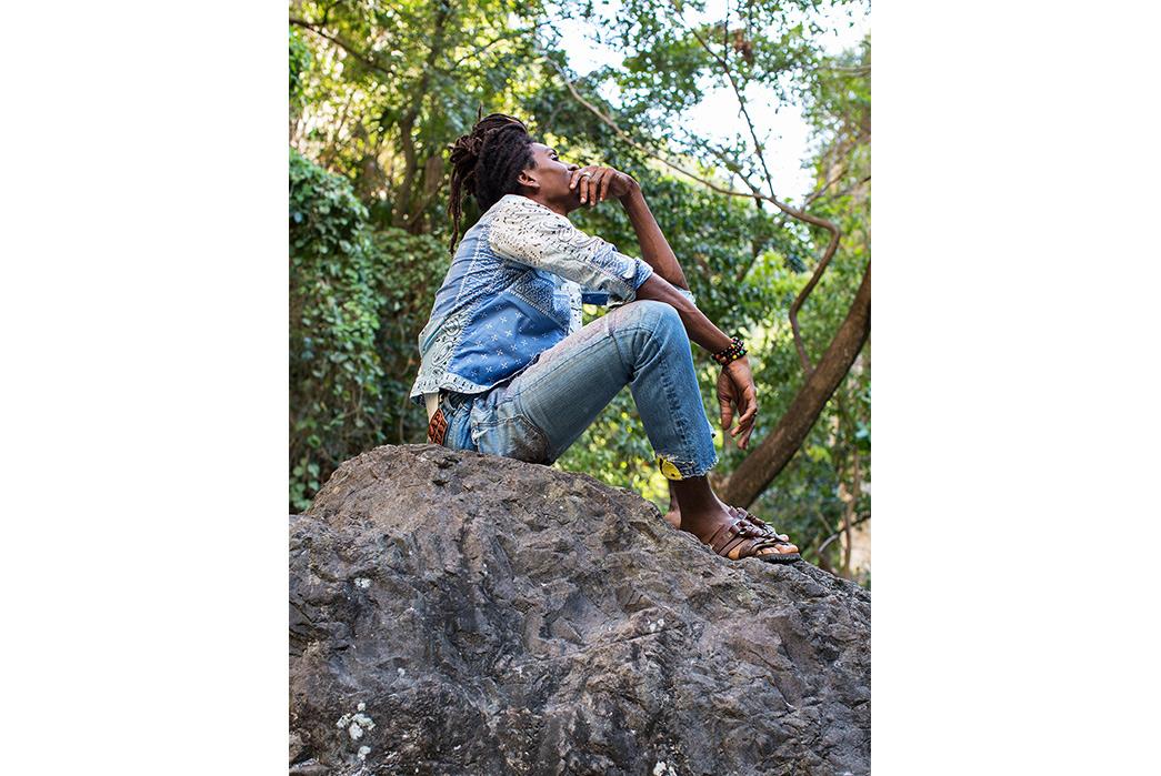 Kapital's-Yardie-Blues-Lookbook-Meanders-Through-Jamaica-and-Misadventure-male-on-big-rock