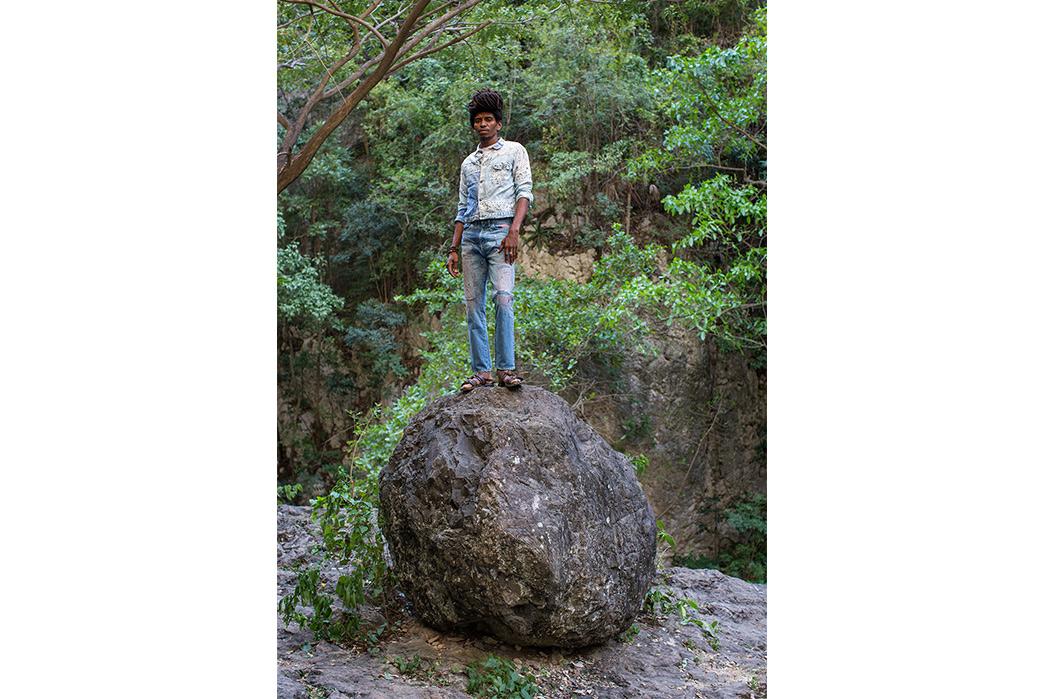 Kapital's-Yardie-Blues-Lookbook-Meanders-Through-Jamaica-and-Misadventure-male-on-big-stone