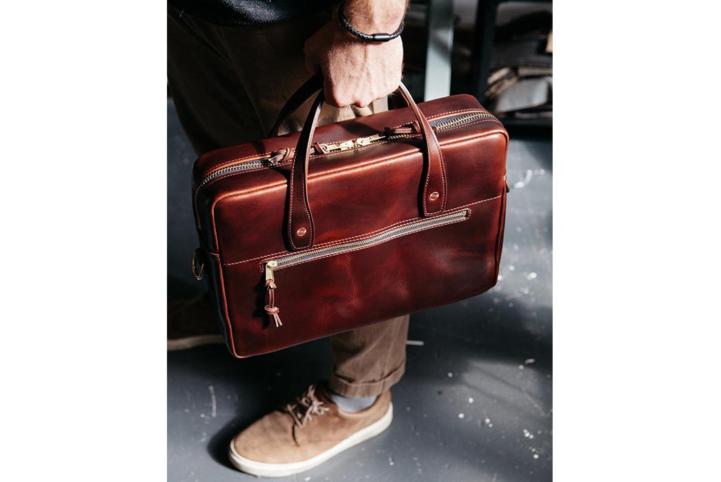 Loyal-Stricklin-Briefcases-in-model-hand