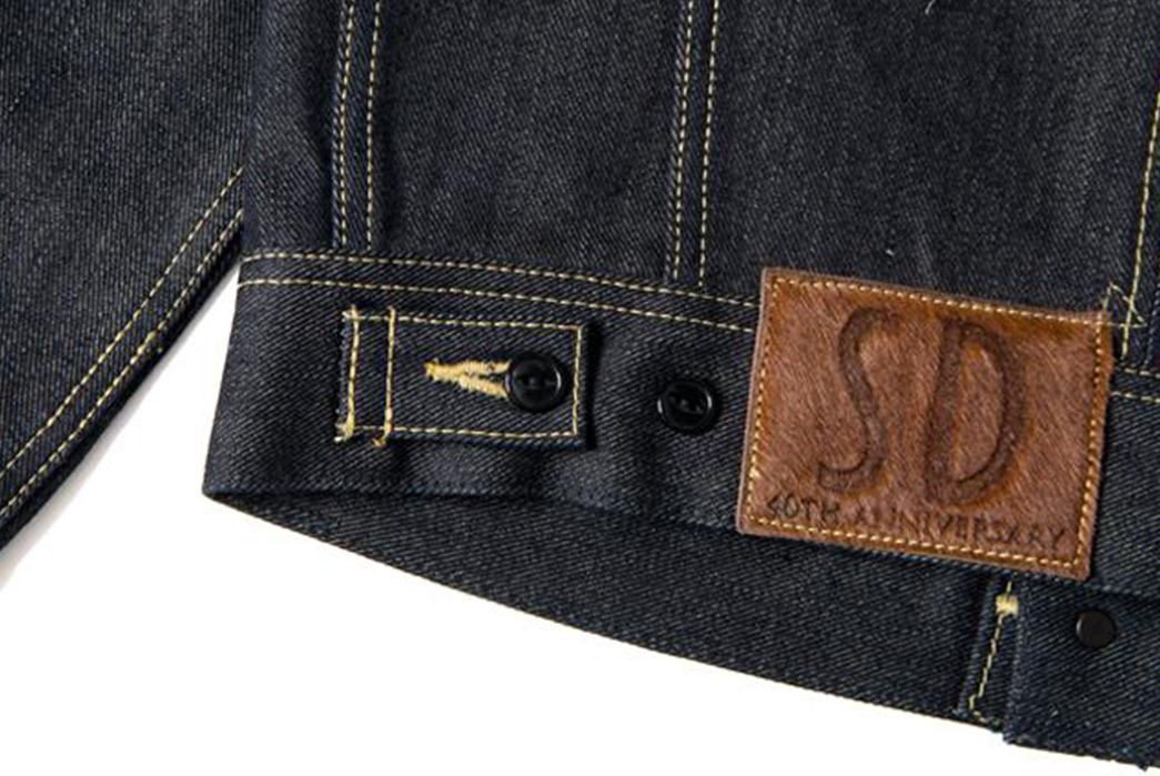 Studio-D'Artisan-Celebrates-40-Years-with-an-Ambidextrous-Capsule-jacket-back-down-selvedge-leather-patch