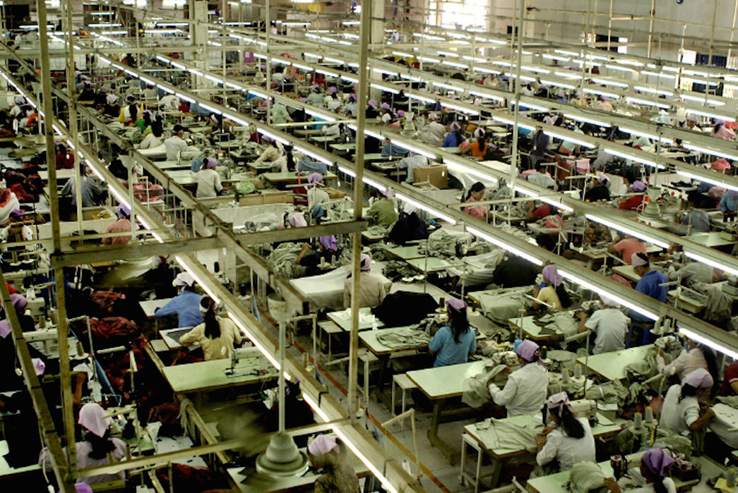 Greenwashing---How-to-See-Through-Disingenuous-Eco-Marketing-The-production-line-at-a-a-factory-showing-garment-workers-(image-via-The-Business-of-Fashion).