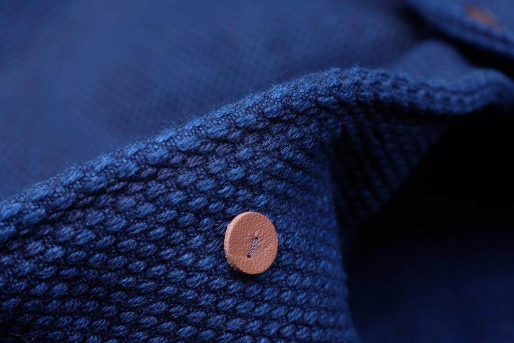 Introduce-The-Office-To-Sashiko-With-Studio-d'Artisan's-Kasezome-Dyed-Sashiko-Tailored-Jacket-front-button-detailed