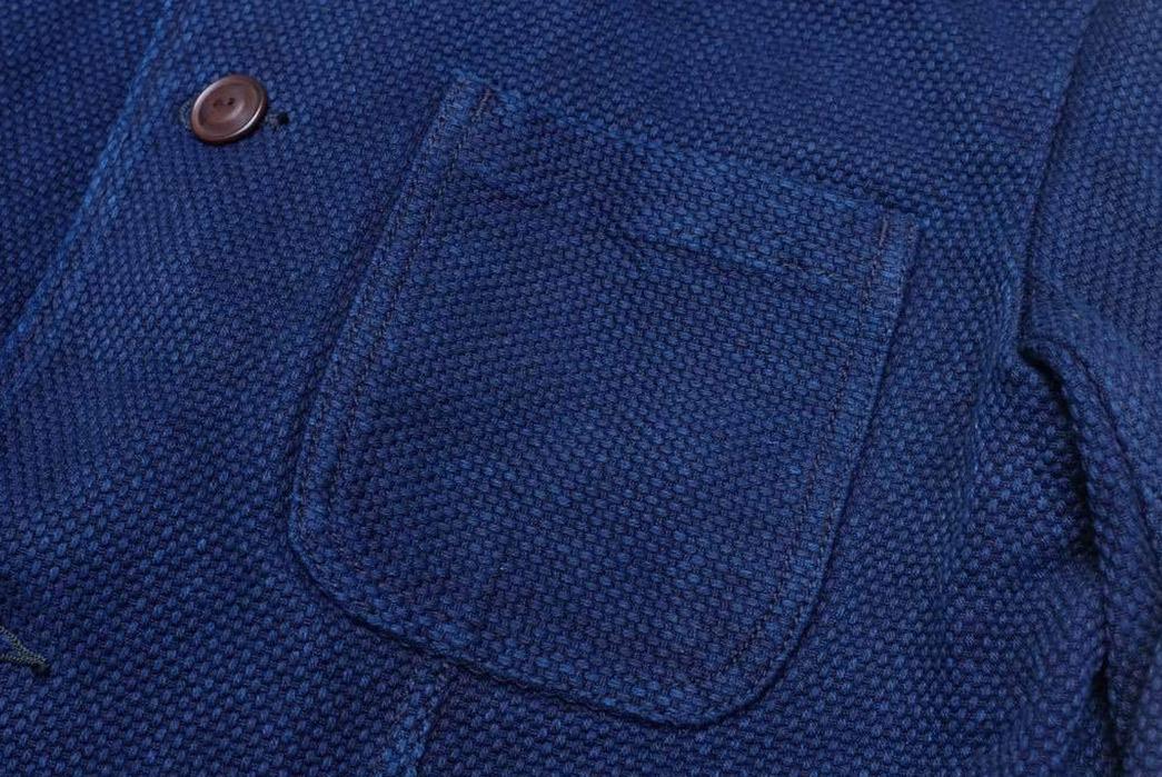 Introduce-The-Office-To-Sashiko-With-Studio-d'Artisan's-Kasezome-Dyed-Sashiko-Tailored-Jacket-front-pocket-and-button