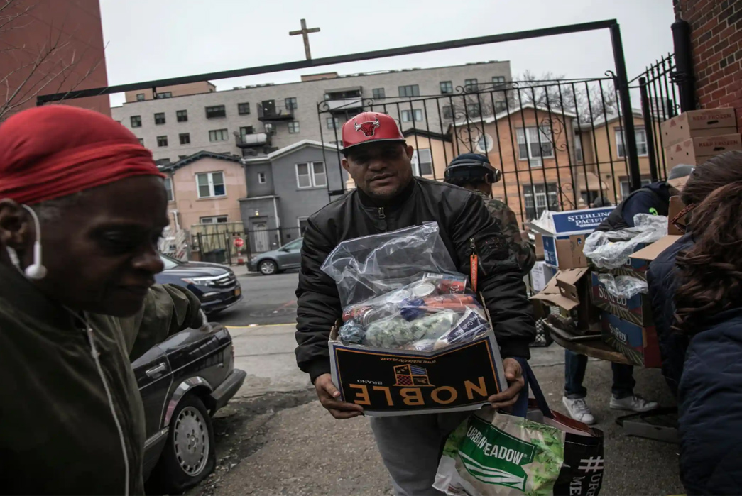 Mutual-Aid---How-to-Build-and-Help-Your-Community-Image-via-Jack-Arts-Volunteers-at-Brooklyn s-St-Stephen-Outreach-carry-food-donations.-Image-via-The-Guardian