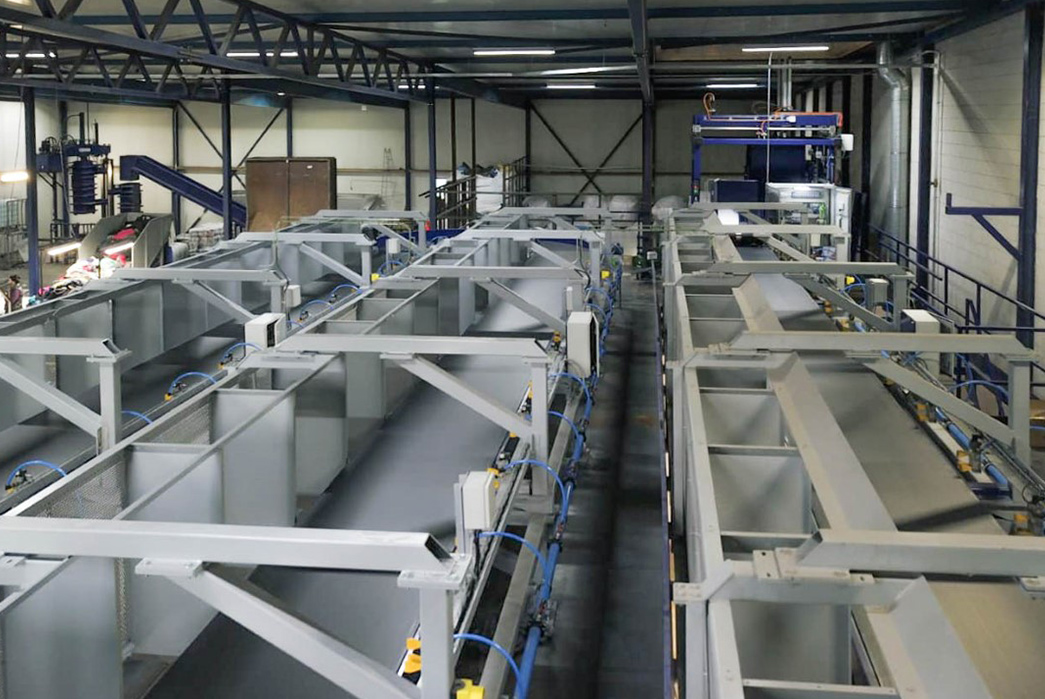 Fibersort, an innovative textile sorting machine capable of processing 900kgs of post-consumer textiles per hour, ready for recycling. Image via Wieland Textiles