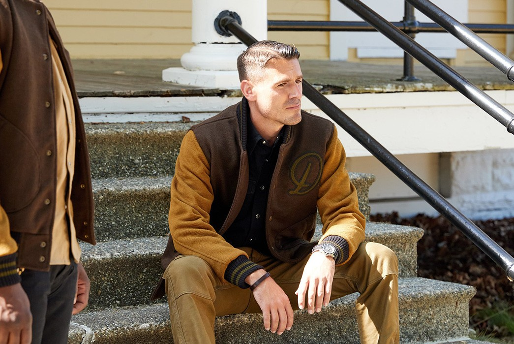 Division-Road-Army-Work-Club-Capsule-Collection-two-males-in-brown-jackets-2