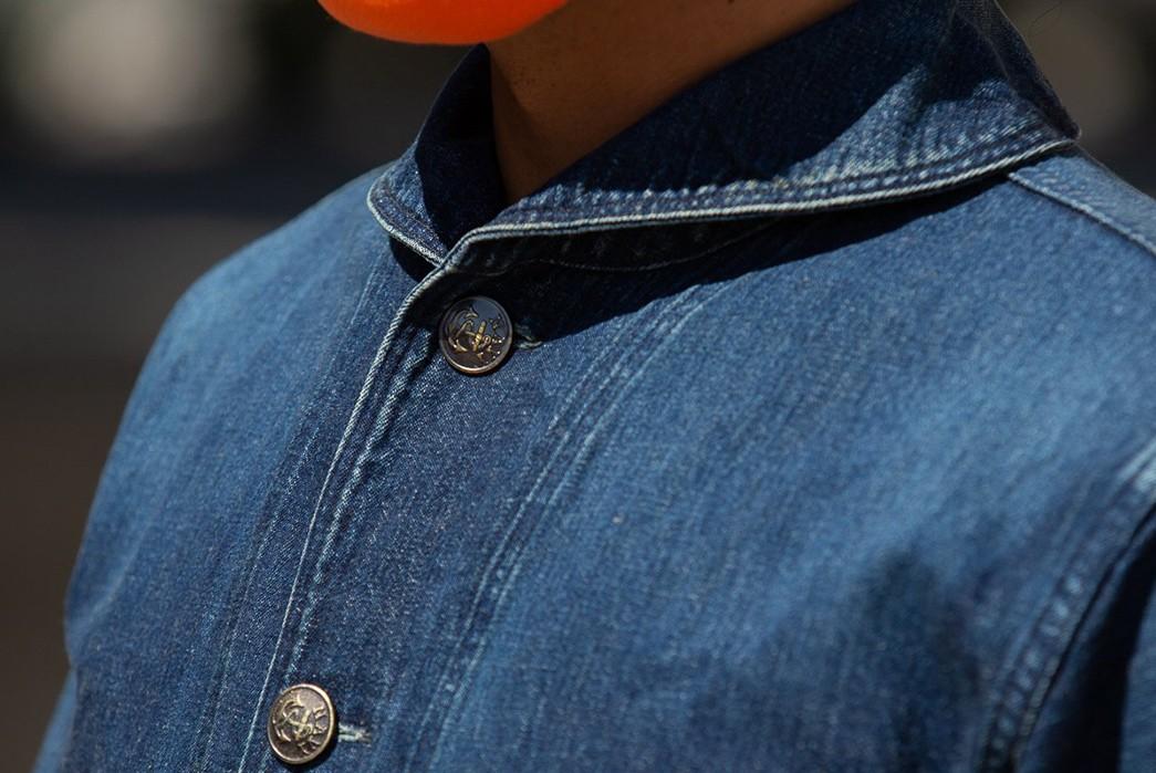Warehouse-Decks-Out-a-Classic-USN-Jacket-In-Custom-Washed-Denim-model-side