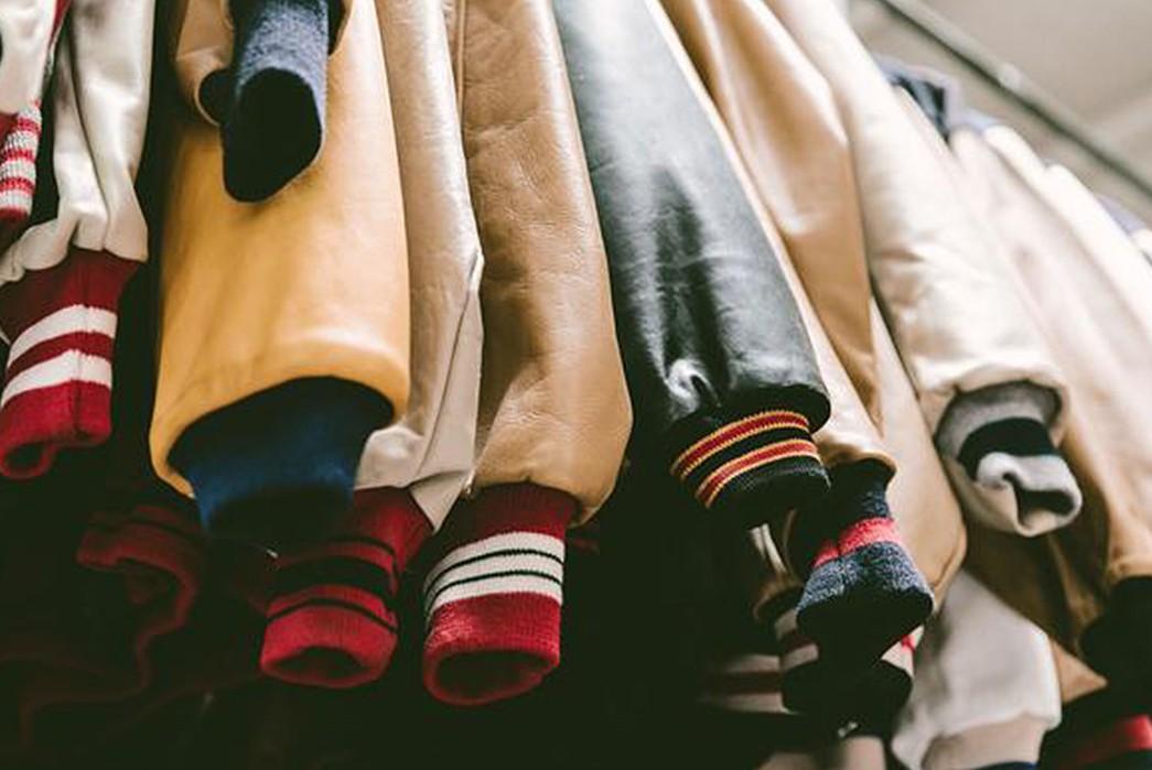 Brand-Profile-Golden-Bear...Captains-of-the-Varsity-Jacket-hanged-jackets