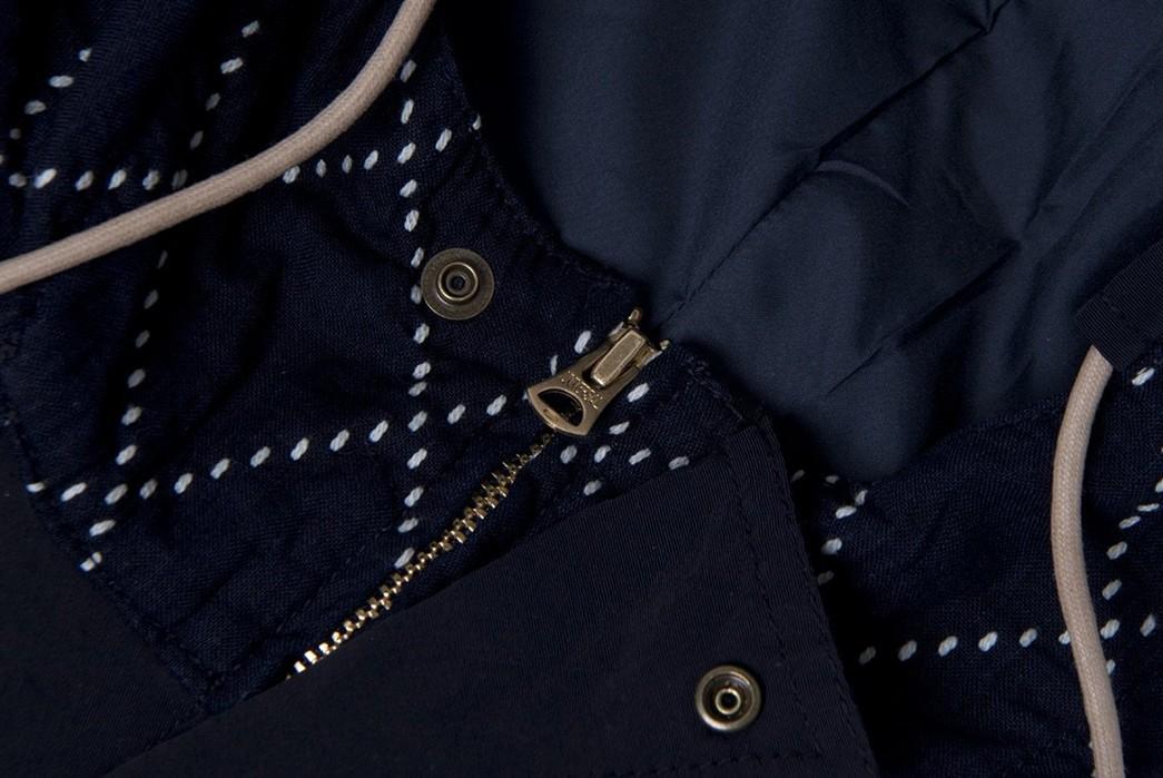 Studio-D'Artisan-Applies-Sashiko-Detailing-To-A-Classic-Mountain-Parka-front-top-zipper