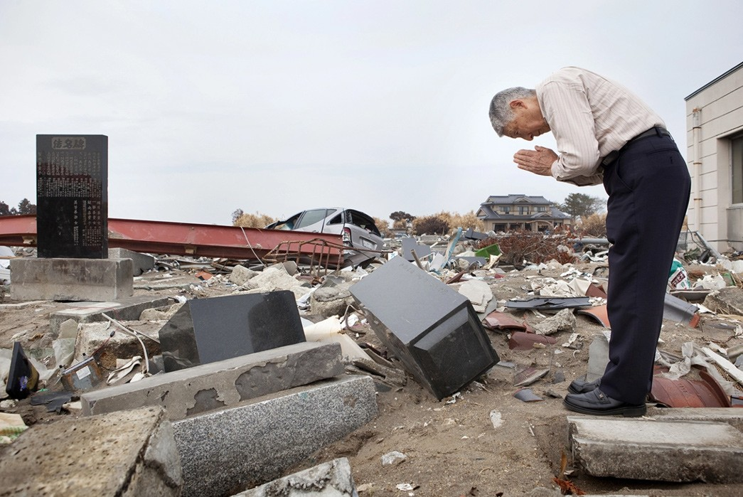 Eric-Kvatek-on-the-10-Year-Anniversary-of-the-Fukushima-Disaster-male-praying-on-graves