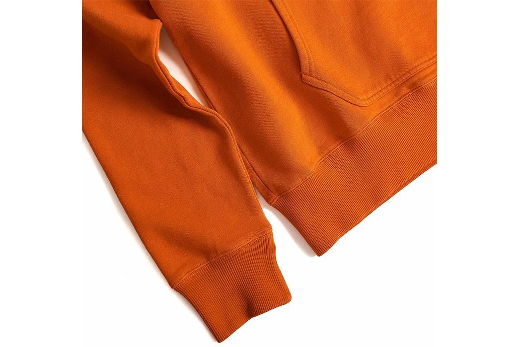 TSPTR-Carves-Up-Its-Base-Hooded-Sweatshirt-In-Pumpkin-Orange-front-down