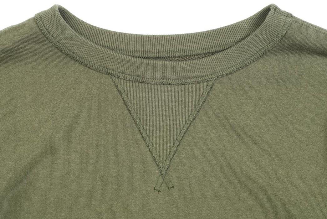 Storm-The-Court-In-Jelado-s-6th-Man-3-4-Sleeve-Sweatshirt-front-collar