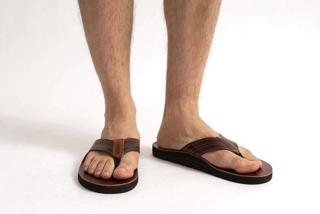 American-Trench-Collaborates-With-Island-Slipper-For-Quartet-Of-Leather-Sandals-pair-brown-on-model