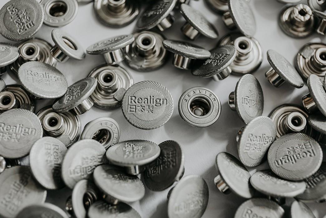 Robin-Denim-Launches-Its-Own-Denim-Line-Realign-Denim-buttons